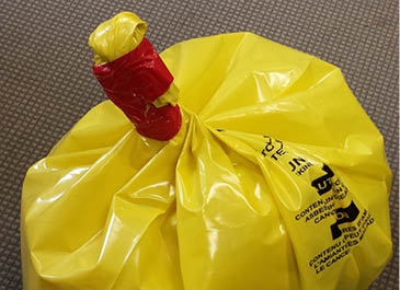 Image of a properly sealed bag of asbestos