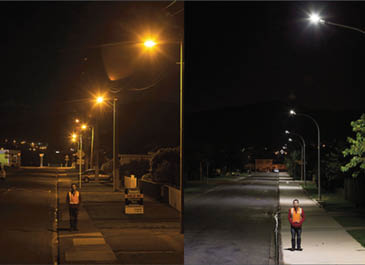 Image of man standing under LED streetlights