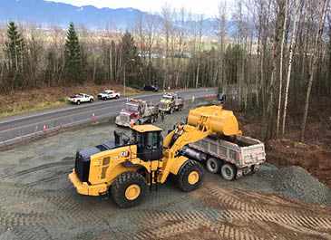 Image of an excavator unloading into a dump truck
