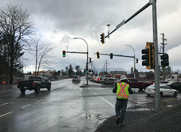 Image of a man standing at an intersection