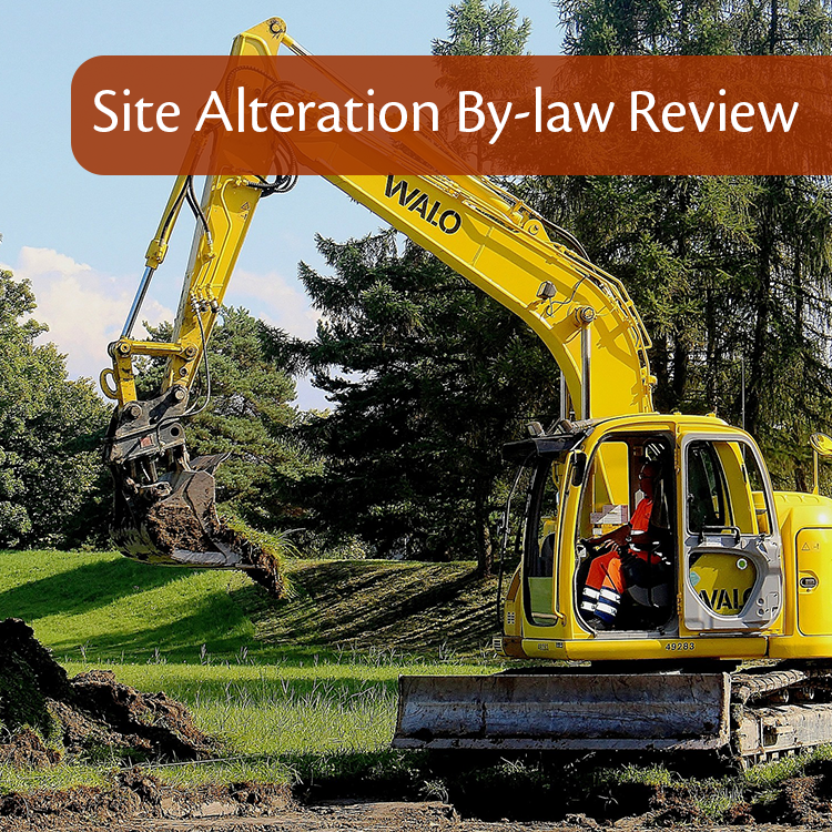 Image of construction equipment pulling up grass and dirt